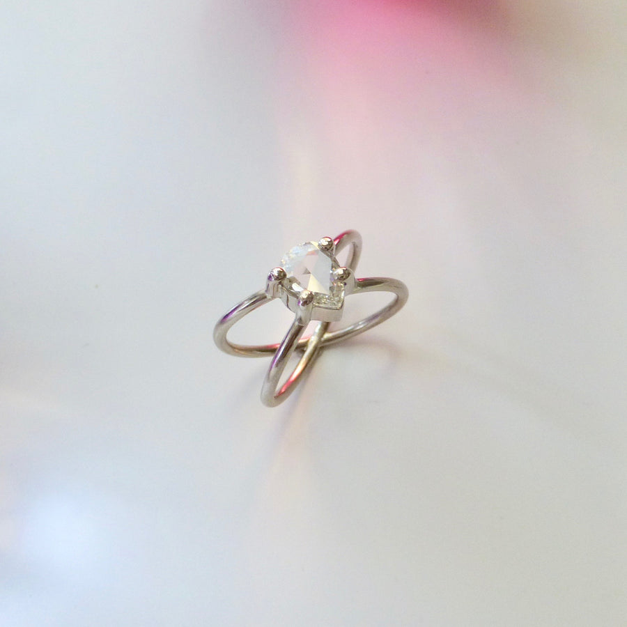 White gold engagement ring with rose cut, pear shaped diamond.