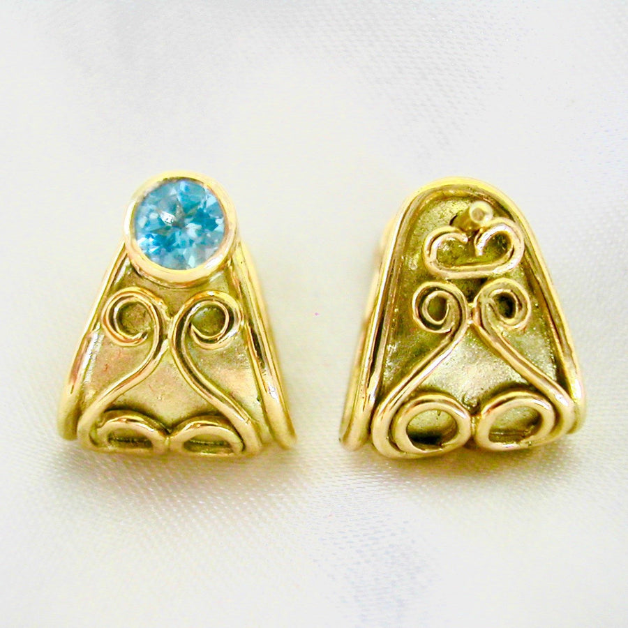 Gold Cuff Earrings with Blue Topaz Gemstones.