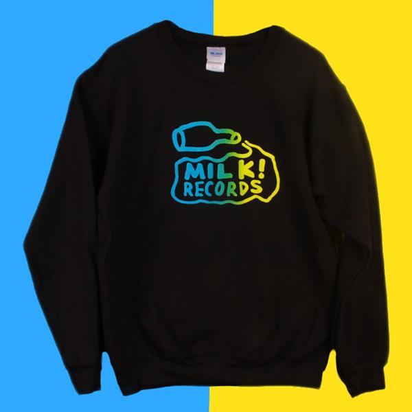 Milk Records logo jumper. Milk bottle spilling milk. Black jumper. Yellow and blue print.