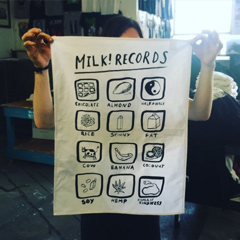 MILK! RECORDS Assorted Milks - Courtney Barnett [ARTIST SERIES] TEATOWEL. ARTIST SERIES, SALE, TEATOWEL. Official merchandise exclusive to Milk! Records Store.