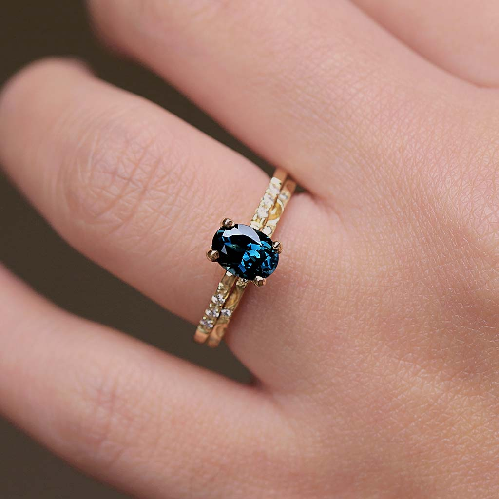 Oval Teal Blue Parti Sapphire Solitaire Ring