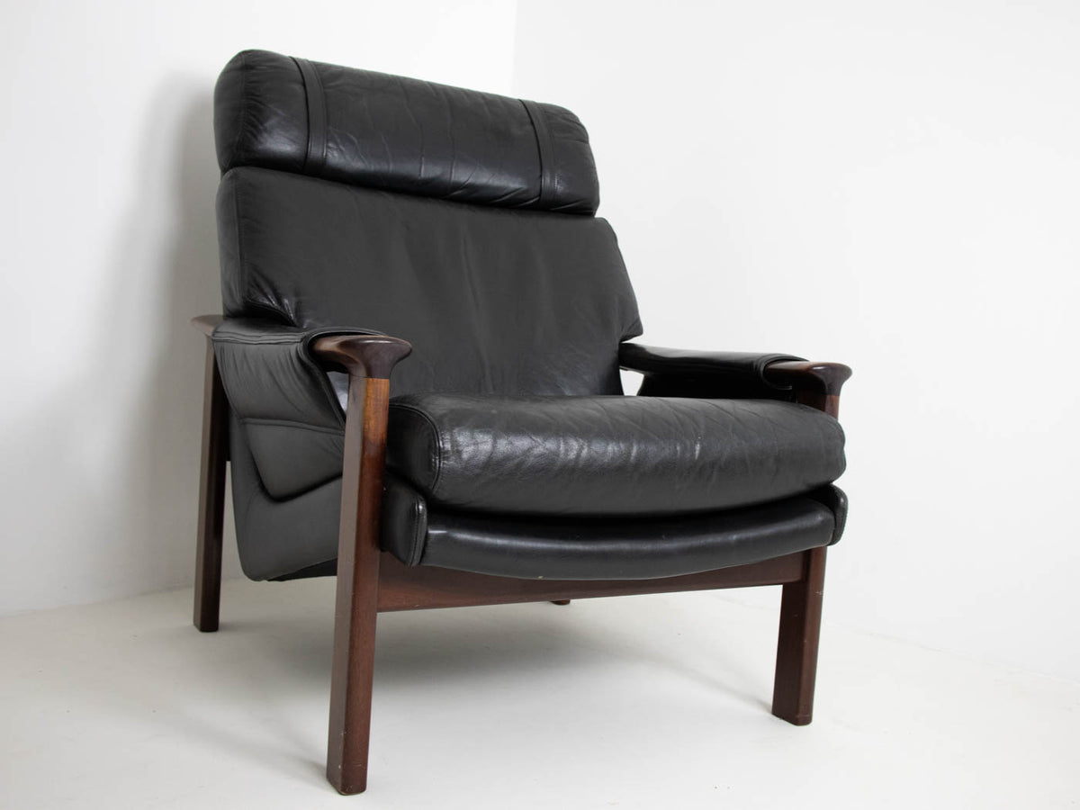 Leather armchair with footstool