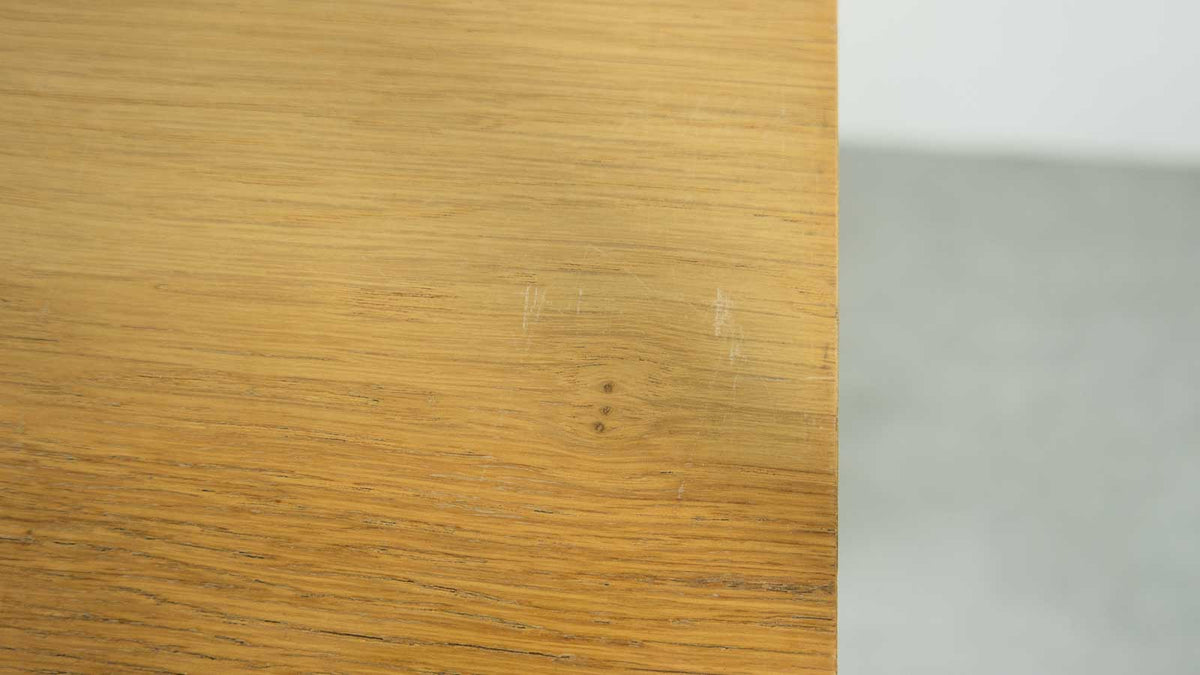 Scuff in veneer on top of cabinet