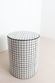 White tiled bedside table