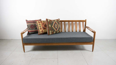 strung back sofa with cushions