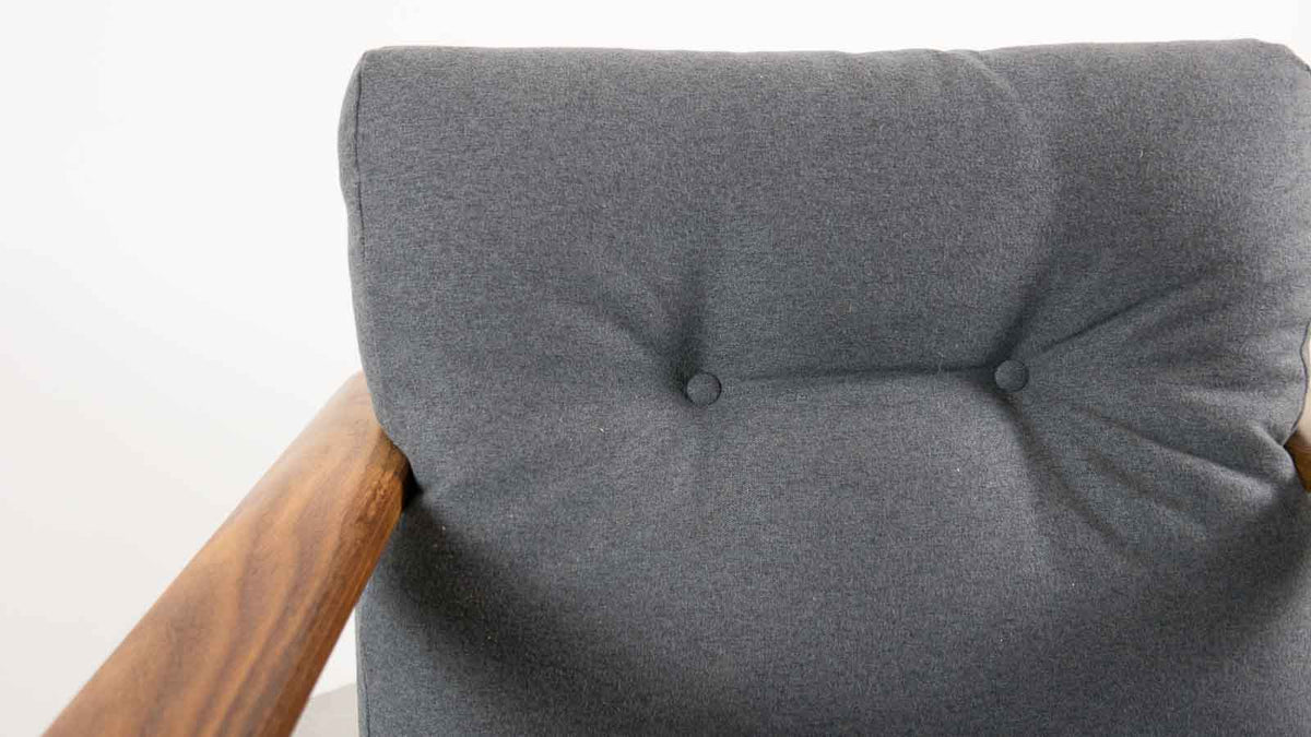 re-upholstered teak armchair