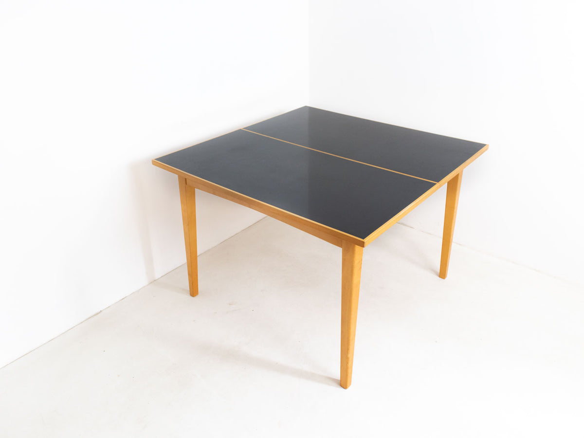 Extendable mid century modern dining table