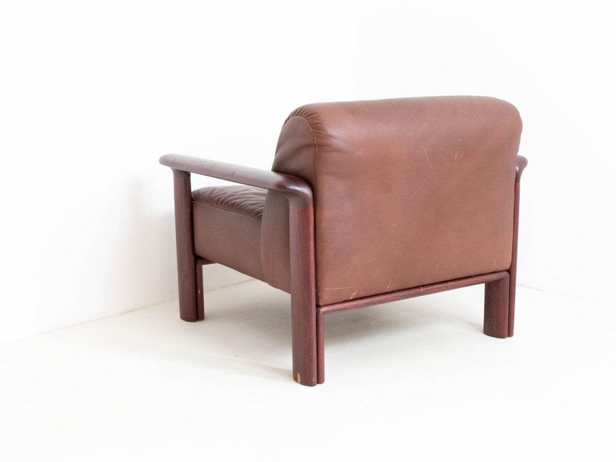 Vintage leather armchair wooden arms