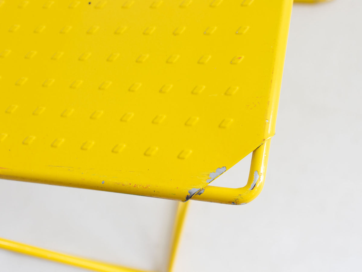 Yellow and blue stacking chairs