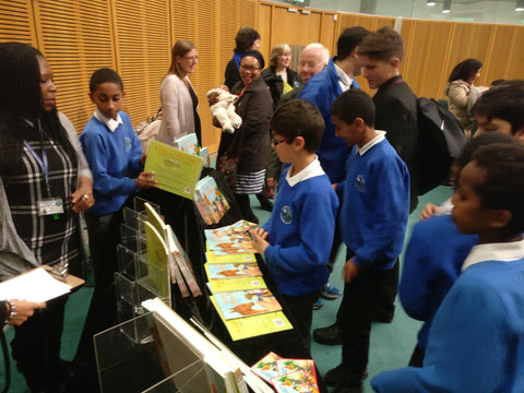 Chalkhill children looking at copies of the book