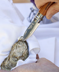 Opinel oyster knife in action.