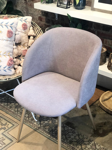 Pale blush chair with steel legs
