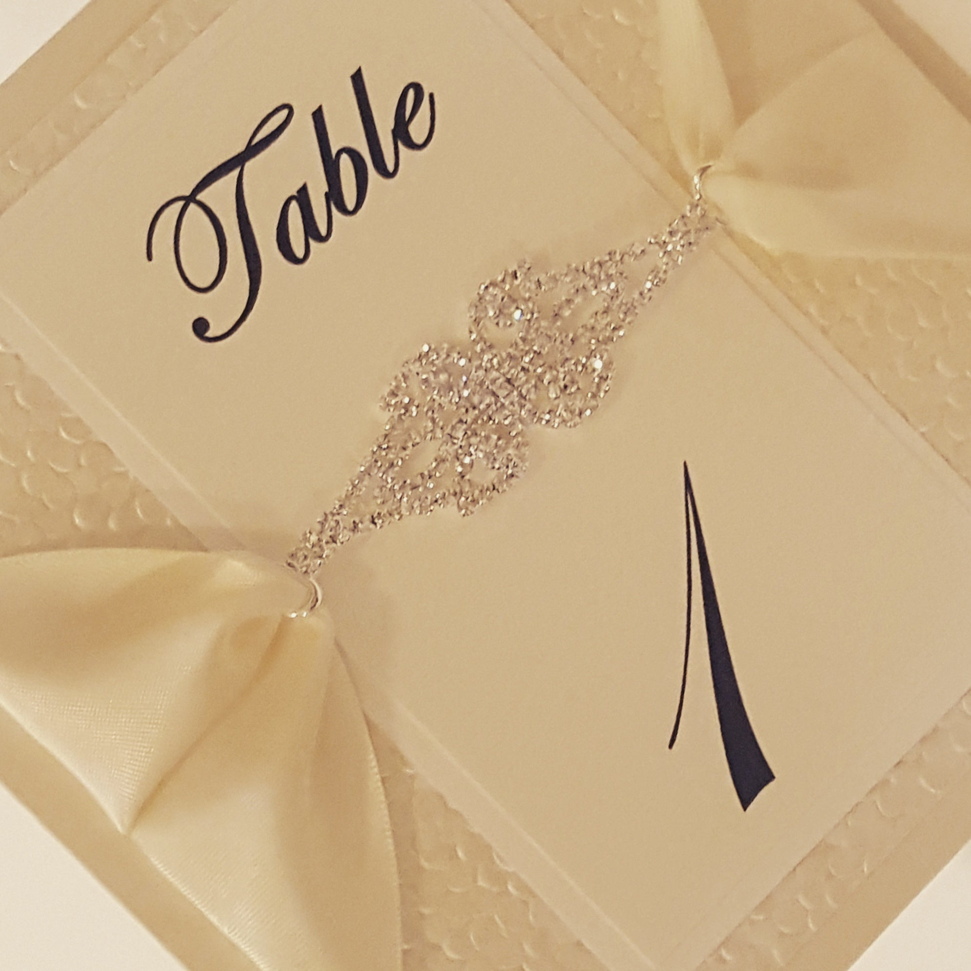 Luxury Pebbles Table Numbers with a Gorgeous Jewel Rhinestone Connector.