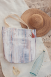 A canvas carry-all tote with a watercolor print