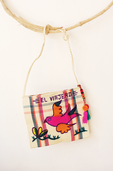 Mexican woven bag with pom pom charm