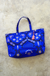oversized beach bag with pom pom charm
