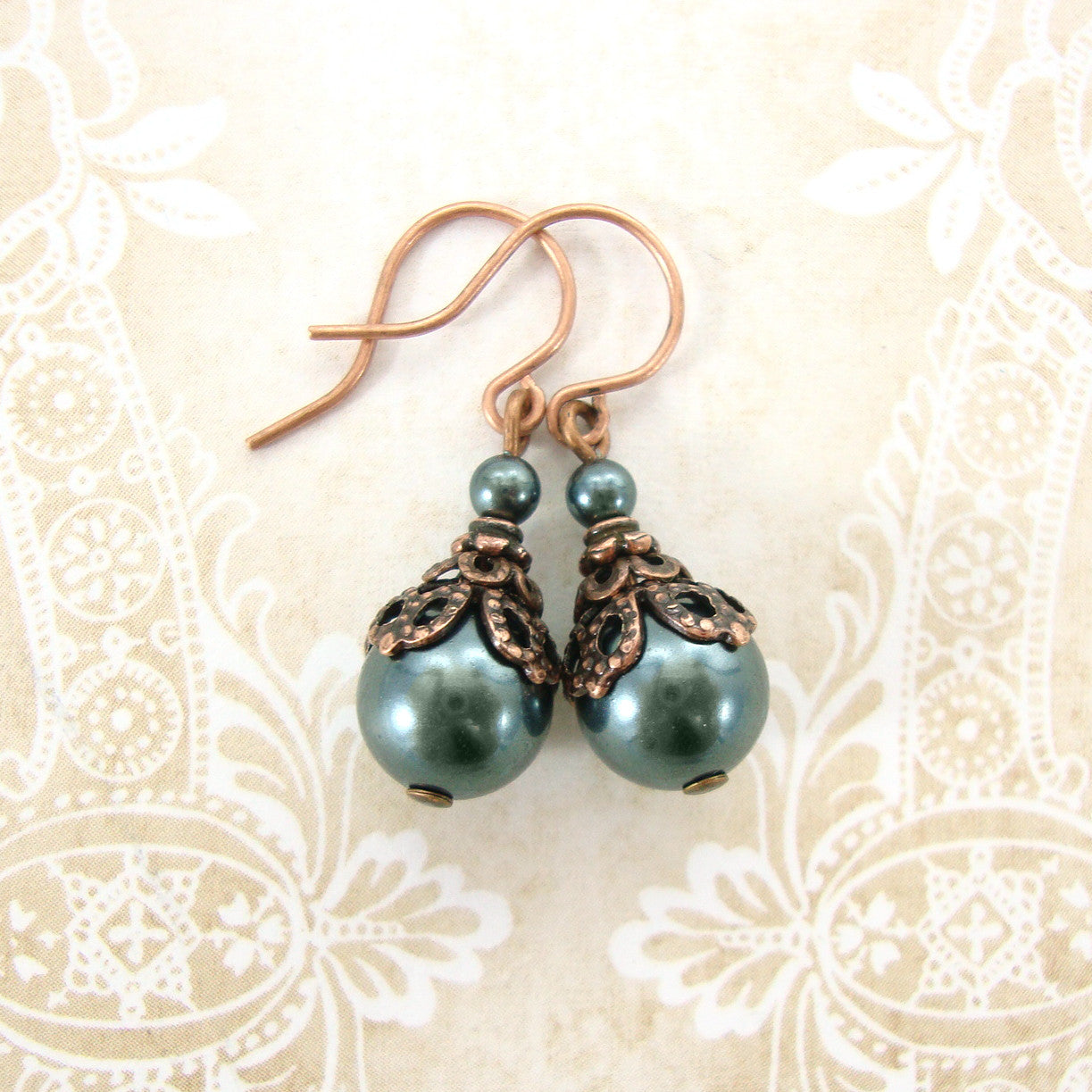 Iridescent green pearl earrings