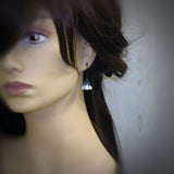 White Gothic Flower Earrings mannequin view