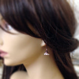 White Copper Flower Earrings mannequin view