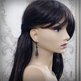 Victorian Gothic Filigree Drop Earrings on mannequin