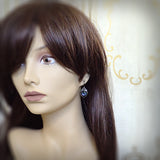 Gunmetal Dusky Blue Stone Earrings on mannequin