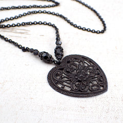 Black metal heart shaped filigree pendant necklace