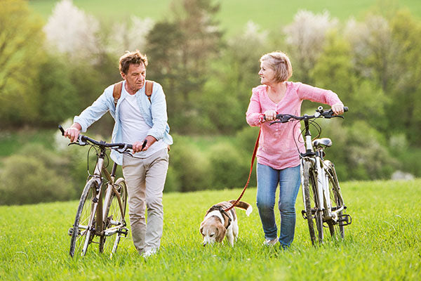 dog biking with man and women