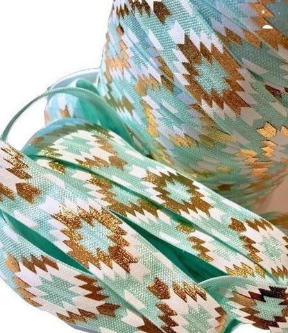 "Aqua blue, white & gold metallic Aztec tribal print 5/8"" fold over elastic FOE - MAE Inspirations  - 1"