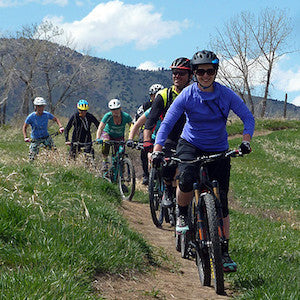 Group Performing Training Mountain Bike Ride as Part of Class