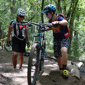 instructor demonstrating mountain bike technique