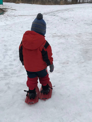 little kid snowshoeing