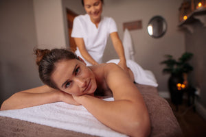 close up of a young woman receiving a massage from a female massage therapist