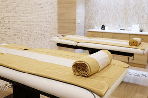 Two empty massage tables in a spa