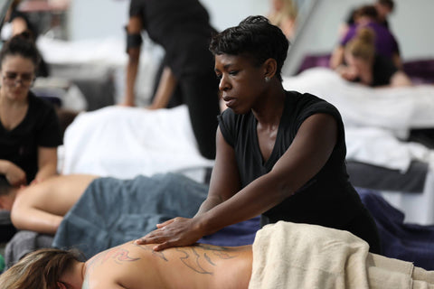 Massage therapist competing in the National Massage Championships