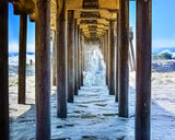 Shooting the Pier Metal Print