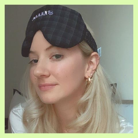 Olivia White the Co-founder and CEO of 41 Winks wears a plush black sleep mask as she gets ready for bed