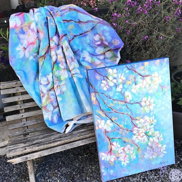 white apple blossom on blue sky & gold leaf, cosy floral throw by Anita Nowinska