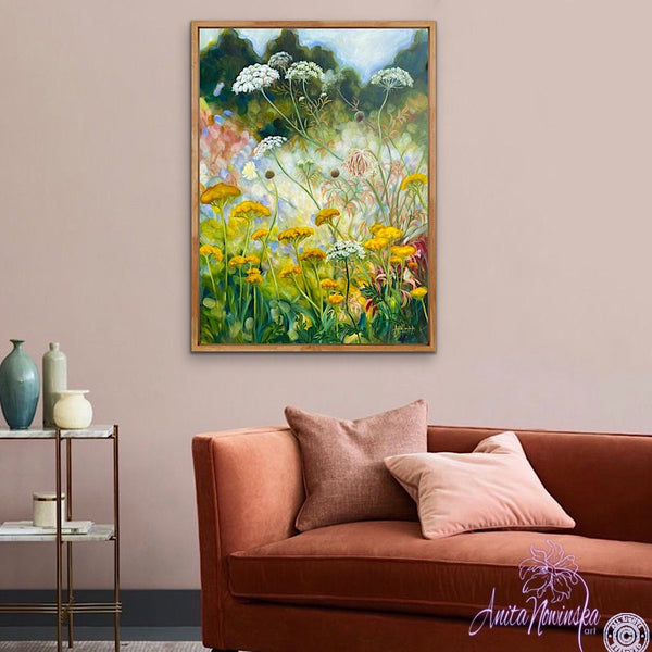 yellow achillea, st annes lace, white cow parsley wild flower painting by anita nowinska in room with burnt orange sofa