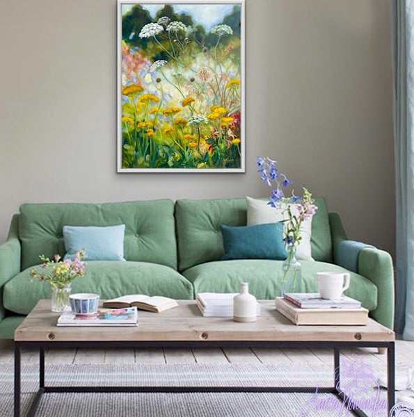 yellow achillea, st annes lace, white cow parsley wild flower painting by anita nowinska in room with green sofa