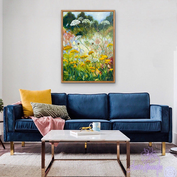 yellow achillea, st annes lace, white cow parsley wild flower painting by anita nowinska in room with navy sofa