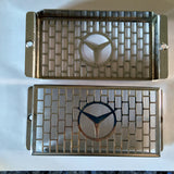 2 NEW GENUINE MERCEDES CHROME GRILLE SCREEN FRONT FOG LIGHT LAMP GUARD R107 280SL 280SLC 350SL 350SLC 500SL 500SLC 450SEL 6.9 450SE 450SEL 450SL 450SLC 450SLC 5.0 380SL 380SLC 560SL