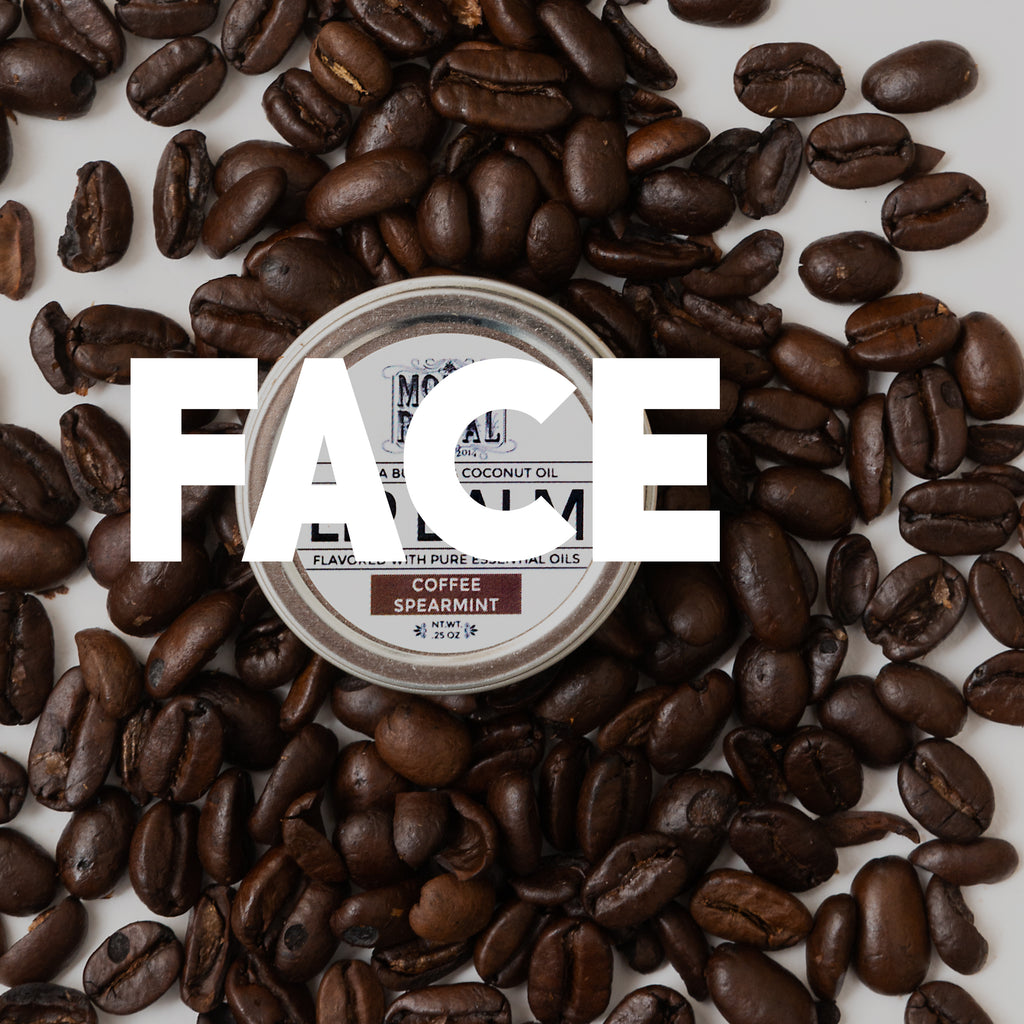 "Cocoa Beans around coffee lip balm with white ""face"" text."