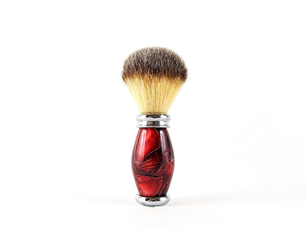 Red designed shave brush.