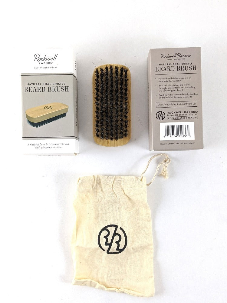 Wooden beard brush with black bristles with carrying pouch.