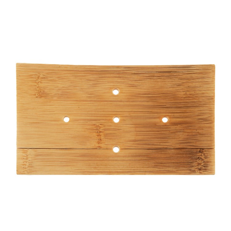 Bamboo wood board with 5 holes poked in it.