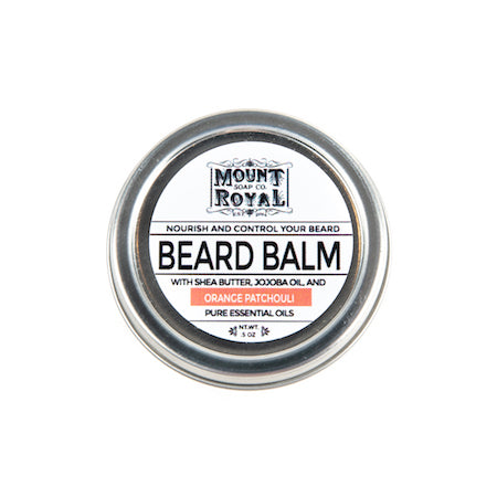 Circular silver and white container of beard balm.