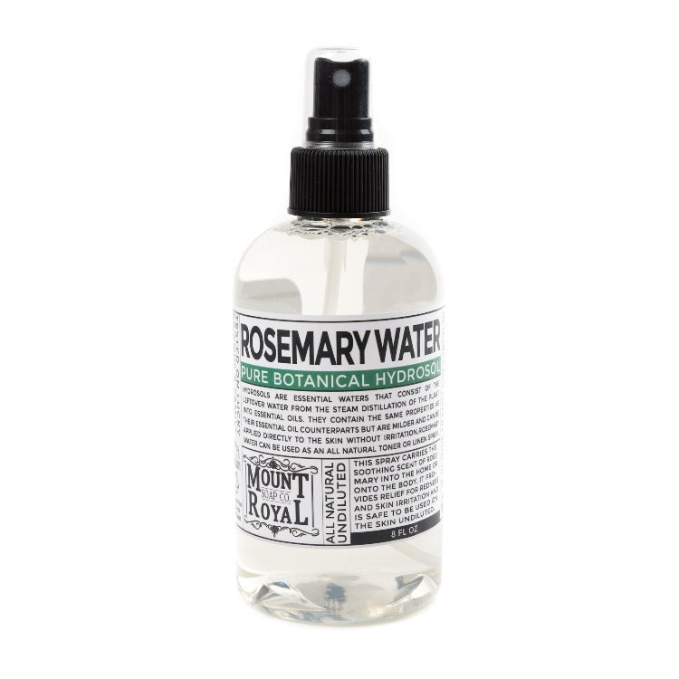 Clear 8 ounce spray bottle full of clear rosemary water.
