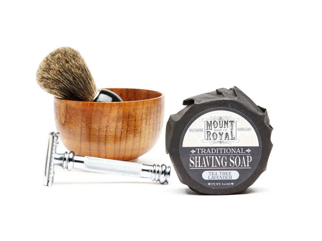 Brush in wooden bowl behind razor behind 3.4 ounce shaving soap.