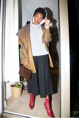 Women's Fall Transition Outfit: Nan Seo Gray Cashmere Double Knit Hoodie and black culottes paired with SOÜF cedar wood clutch
