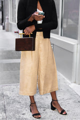 Fall Transition Outfit: Black Cashmere Cardigan, White silk tank and tan culottes paired with brown cedar wood clutch